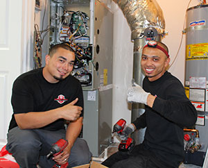Perfect Star Heating and Air Conditioning Concord, CA . Lead Install-Technicians installing a new HVAC system in Blackhawk Danville, CA