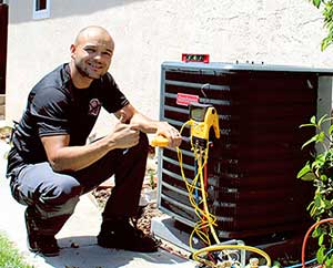 Lead Install Technician, Gilbert Caceres installing a new HVAC system in Antioch, CA