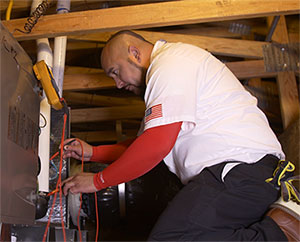 Perfect Star Heating and Air Conditioning Concord, CA Senior Comfort Adviser, Danny Mendoza servicing a client's furnace in Brentwood, CA Heating Furnace page Heating Services